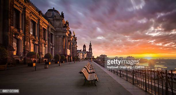 Empty Benches By Dresden Frauenkirche In City During Sunset