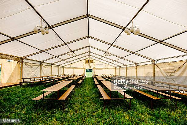Empty Benches On Grass In Tent