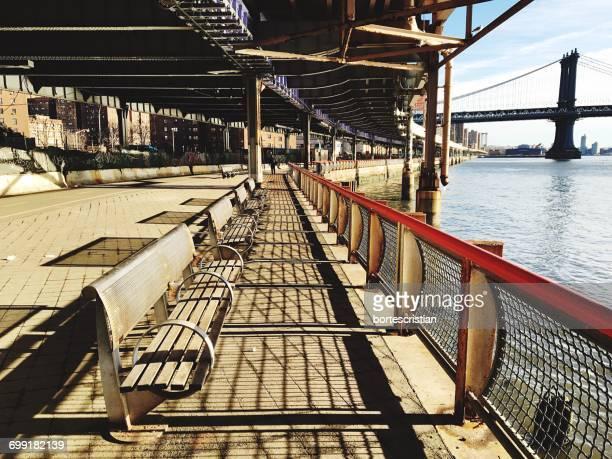 empty benches on promenade - bortes stock-fotos und bilder