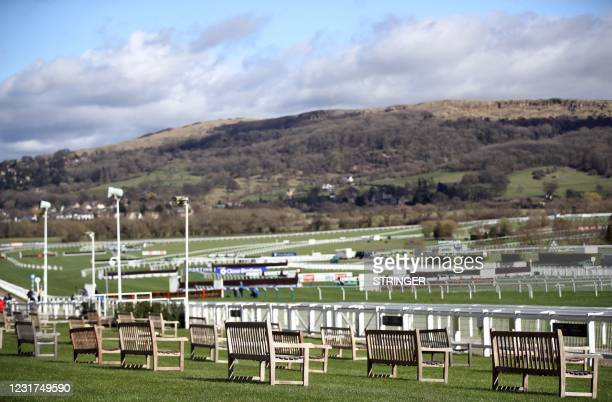 Empty benches overlook the racetrack ahead of Day One of the Cheltenham Festival at Cheltenham Racecourse, in Cheltenham, England on March 16, 2021 -...
