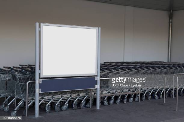 empty billboard against shopping carts - shopping cart stock pictures, royalty-free photos & images
