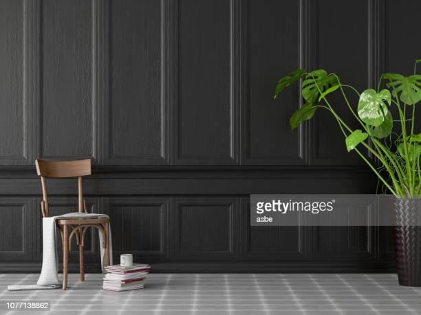 empty black wall panel with wooden chair - wood panelling stock pictures, royalty-free photos & images