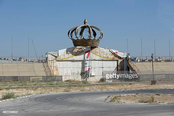 Empty bleachers and a facade are seen from the motorcade traveling with US Defense Secretary Ash Carter as it approaches Queen Alia Airport in Amman...
