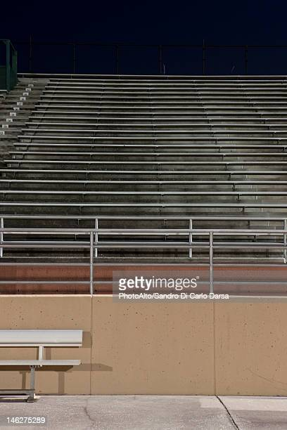empty bleachers at night - empty bleachers stock photos and pictures