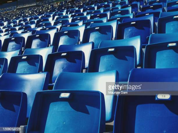 empty blue arena seats with numbers in a stadium - stadion stockfoto's en -beelden