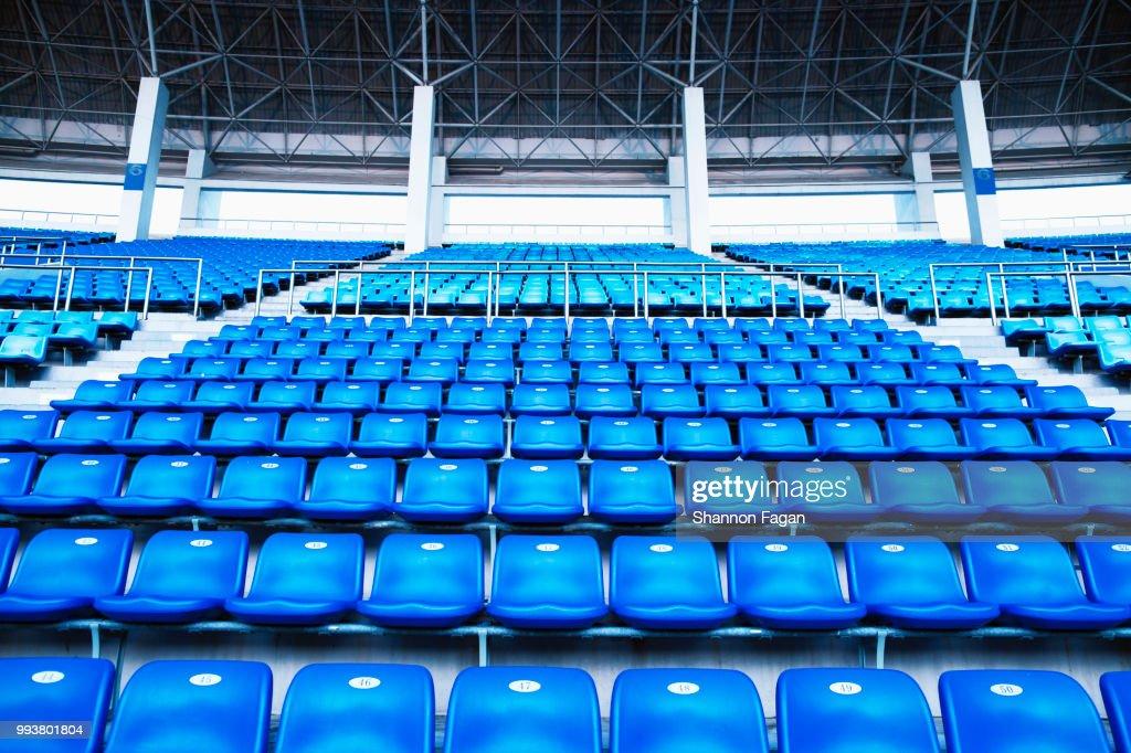 empty blue arena seats with numbers in stadium ストックフォト