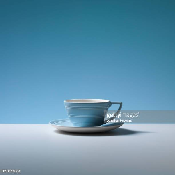 empty blue coffee cup and saucer - saucer stock pictures, royalty-free photos & images