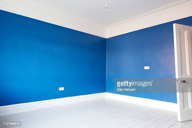 Empty blue painted room