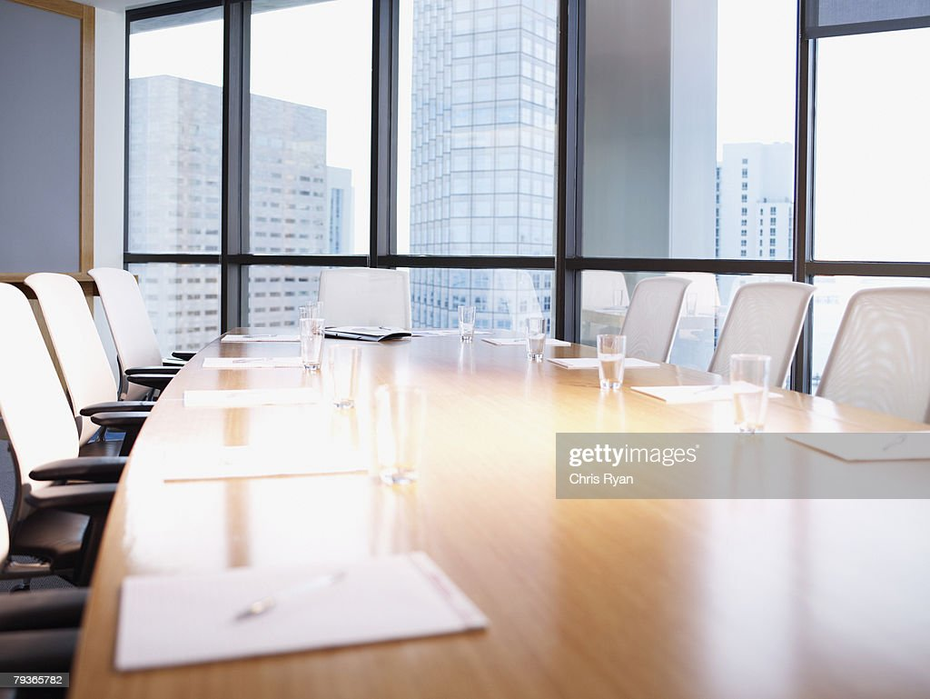 Empty boardroom table with paperwork : Stock Photo