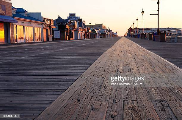 empty boardwalk against clear sky during sunset - new jersey stock pictures, royalty-free photos & images