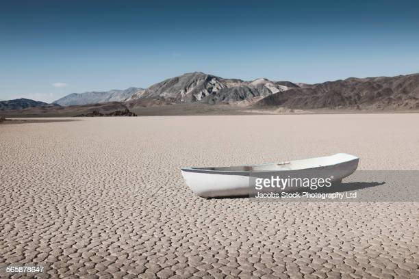 Empty boat in dry desert field