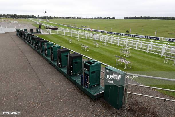Empty bookmaker stalls are seen at Epsom Racecourse on July 04, 2020 in Epsom, England. The famous race meeting will be held behind closed doors for...