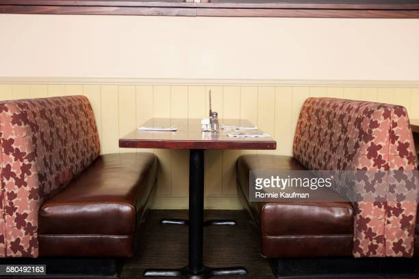 Empty booth and table in restaurant