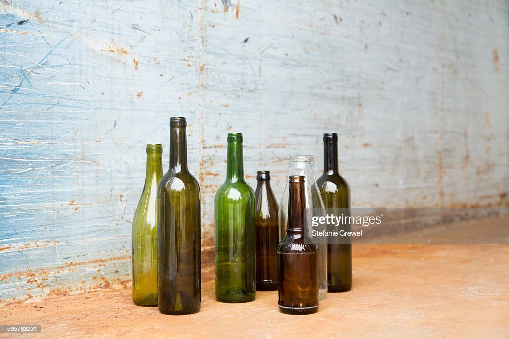 Empty bottles for recycling in front of wall : Stock Photo