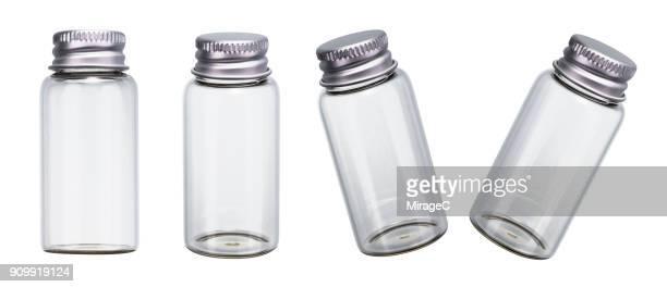 empty bottles on white - 角度 ストックフォトと画像