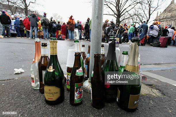 Empty bottles stand along a carnival parade on February 23 2009 in Mainz Germany Hundreds of thousands people flood the streets of Mainz watching the...