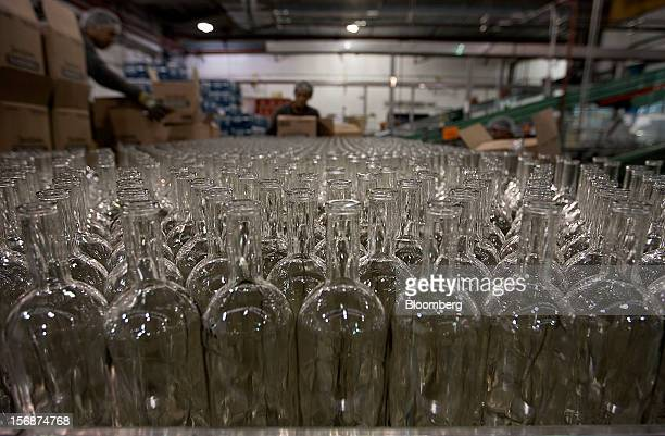 Empty bottles to be used for Jose Cuervo Tradicional tequila wait to be filled at the Tequila Cuervo La Rojena SA de CV bottling factory in...