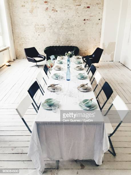 Empty Bowls Arranged On Table By Chairs In Empty Office
