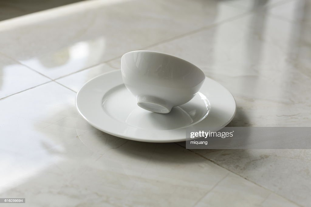 empty bowls, plates and cups on gray background : Stock Photo