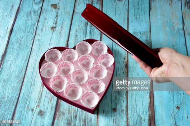empty box of chocolates - box of chocolate stock pictures, royalty-free photos & images