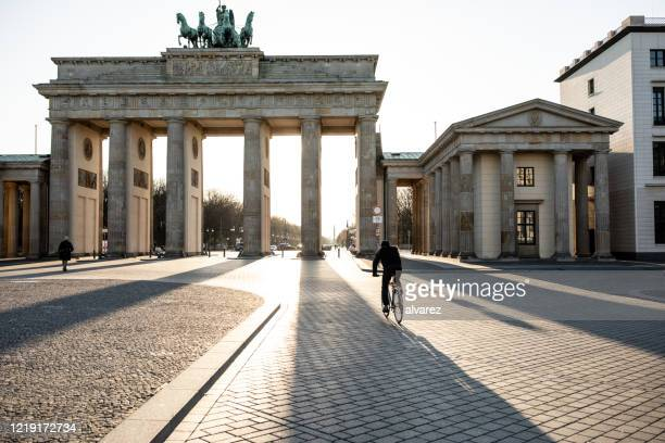 empty brandenburg gate during the covid-19 crisis - germany stock pictures, royalty-free photos & images