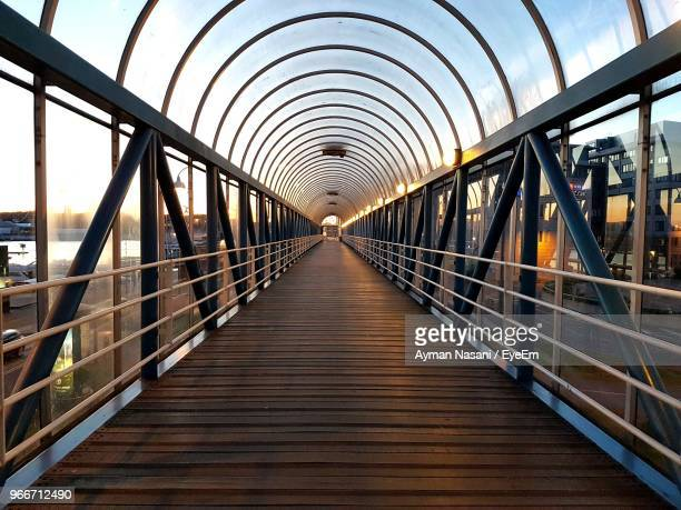 empty bridge against sky - vanishing point stock pictures, royalty-free photos & images