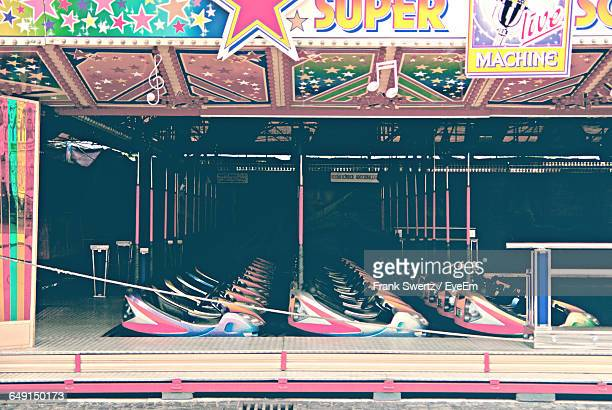 empty bumper cars at amusement park - frank swertz stockfoto's en -beelden