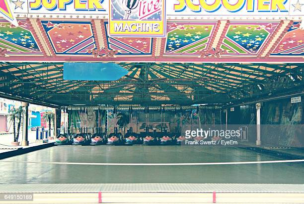 empty bumper cars in amusement park - frank swertz stockfoto's en -beelden