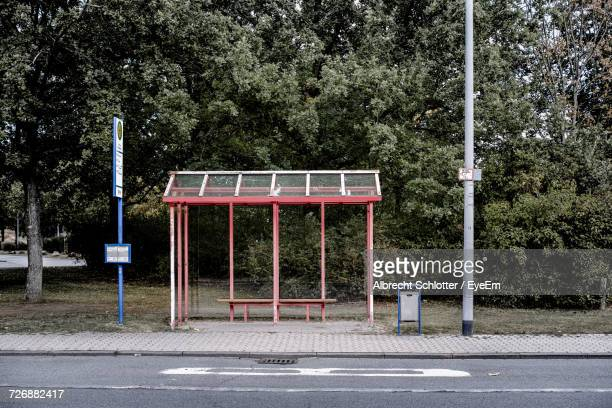 Empty Bus Stop Against Trees