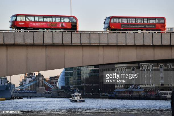 Empty buses are parked on London Bridge in central London on November 29 after reports of shots being fired London Bridge across the River Thames in...