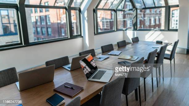 empty business office with a few things on the table - laptop stock pictures, royalty-free photos & images