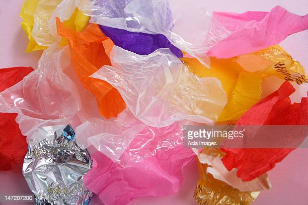 empty candy wrappers - candy wrapper stock photos and pictures