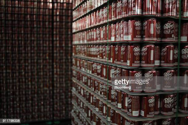 Empty cans of Dr Pepper soda sit stacked in the warehouse before being filled at Dr Pepper Snapple Group Inc bottling plant in Irving Texas US on...