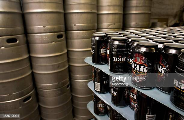 Empty cans sit stacked before being filled with Wynkoop Brewing Co's B3K Black Lager at the company's facility in Denver Colorado US on Thursday Jan...