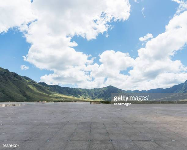 empty car park front of range of mountains - front view ストックフォトと画像