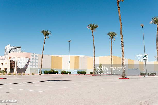 empty car park in front of big building, palm tree