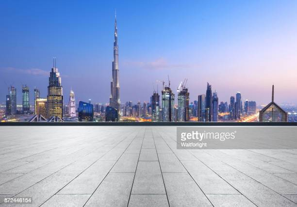 Empty car parking with Dubai downtown background