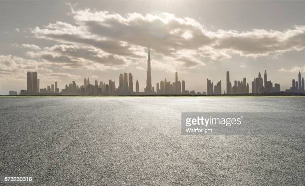 empty car parking with dubai urban skyline background - roadside stock pictures, royalty-free photos & images