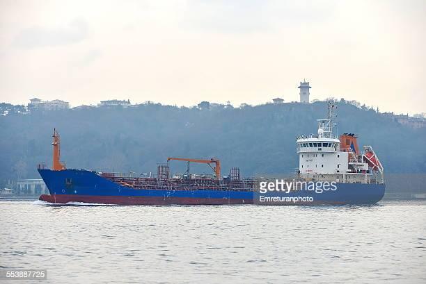 empty cargo ship passing thro bosphorus - emreturanphoto stock pictures, royalty-free photos & images