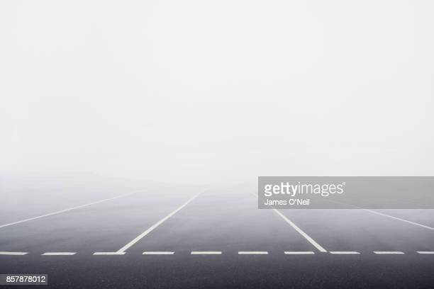 Empty carpark with thick fog