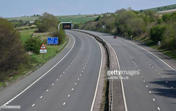 Empty carriageways of the M4 motorway are pictured near Swindon, western England, on April 11 as life in Britain continues over the Easter break,...