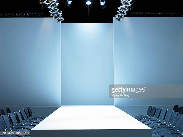 empty catwalk and seating for fashion show - modenschau stock-fotos und bilder