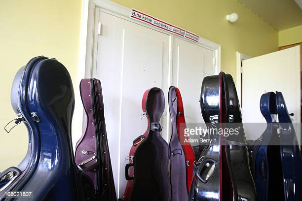 Empty cello cases belonging to the cellists of the ORSO Rock Symphony Orchestra stand backstage during a rehearsal for the ORSO RockSymphonyNight in...