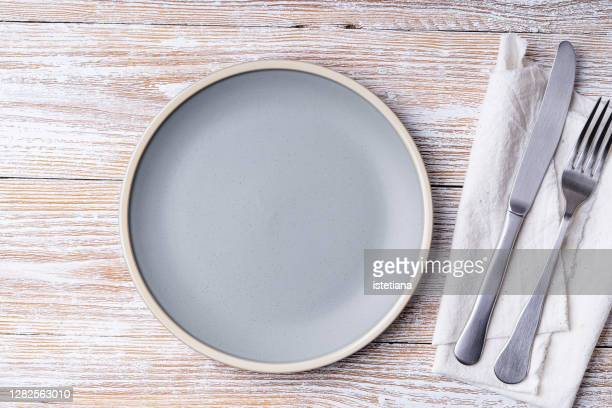 empty ceramic plate on rural wooden background - plate stock pictures, royalty-free photos & images