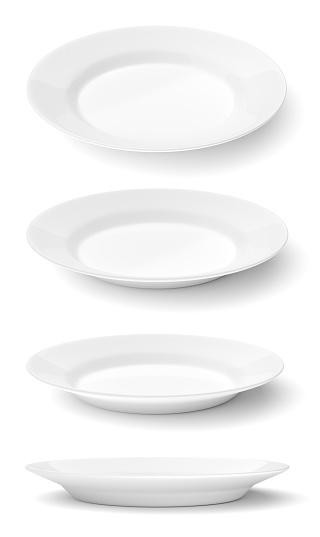 Empty ceramic round plates isolated on white 481951958