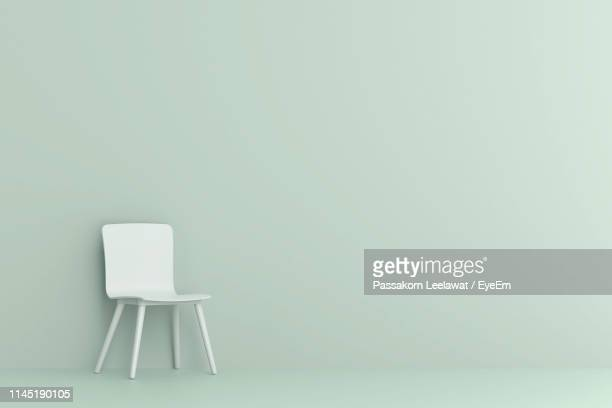 empty chair against colored background - 椅子 ストックフォトと画像