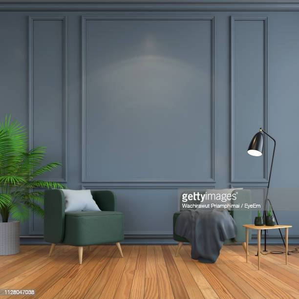 empty chair against wall at home - armchair stock pictures, royalty-free photos & images