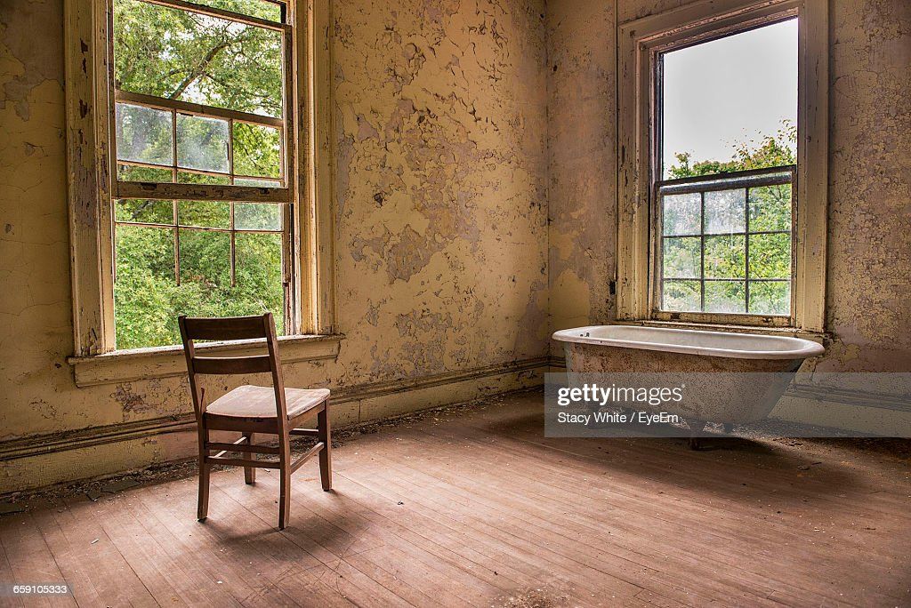 Empty Chair And Bathtub In Abandoned House Stock Photo | Getty Images