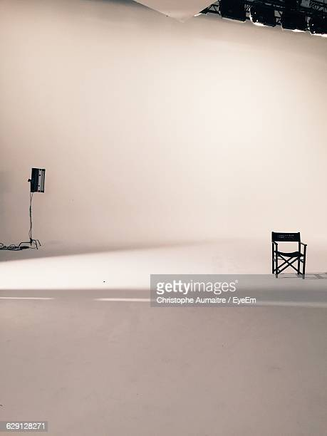 empty chair and lighting equipment at film set - film studio stock pictures, royalty-free photos & images