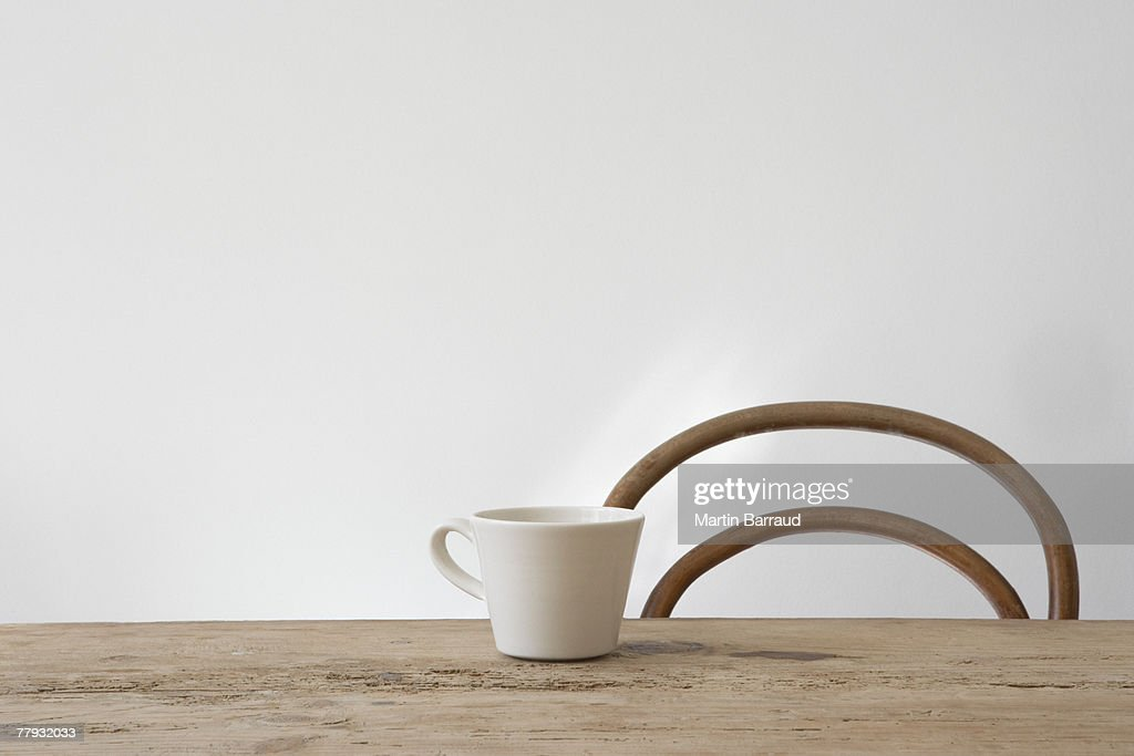 Empty chair and mug on table : Stock Photo